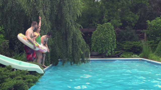 young adult  jumping diving pool party outdoor summer bbq - large stock videos & royalty-free footage