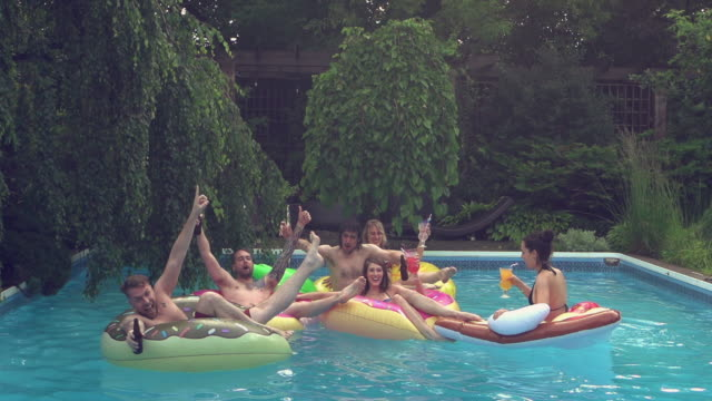 young adult  jumping diving pool party outdoor summer bbq - barbecue social gathering stock videos & royalty-free footage