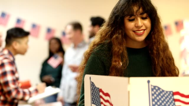 young adult, latin descent woman votes in usa election. - local politics stock videos & royalty-free footage