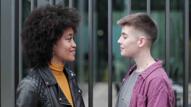 young adult lesbian couple kissing outdoors in city - kissing stock videos & royalty-free footage