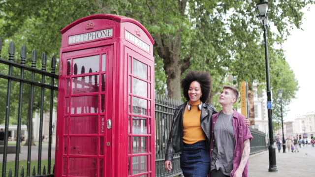 young adult lesbian couple on vacation in london - telephone booth stock videos & royalty-free footage
