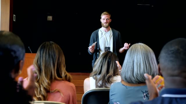 young adult male conference speaker talks to audience - public speaker stock videos & royalty-free footage