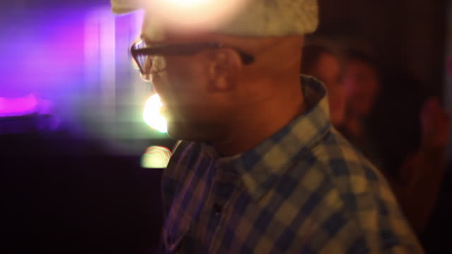 stockvideo's en b-roll-footage met young adult male dancing with females at party - concert