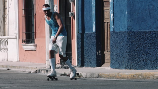 young adult male rollerblade in urban street - blade stock videos & royalty-free footage