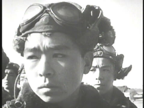 young adult males in pilot uniforms lined up in rows. young male pilot. imperial officer speaking to group . kamikaze, or uhka, shimpu . wwii, world... - 飛行士点の映像素材/bロール