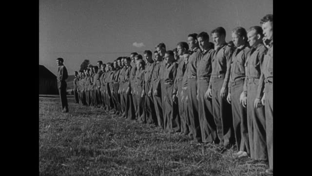 vídeos de stock e filmes b-roll de young adult males in uniform standing in long row relaxing in camp young adult males of civilian conservation corps boxing in outdoor ring playing... - camisola de basebol