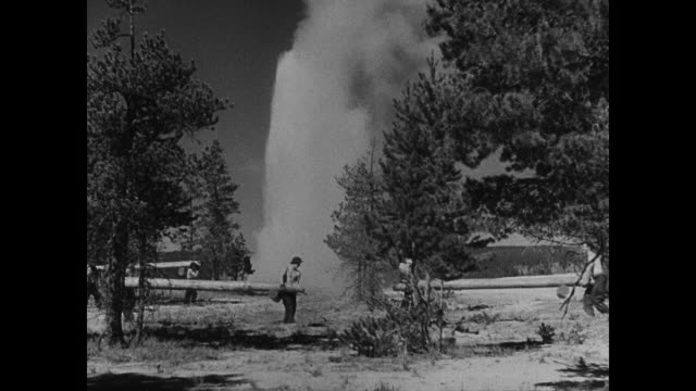 night young adult males of civilian conservation corps spotting raising alarm rushing to fight forest fire in the dark - 1935 stock-videos und b-roll-filmmaterial