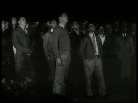 LOSS Young adult males singing Stanford University alma mata song to President Herbert Clark Hoover standing w/ family on balcony greeting singers at...