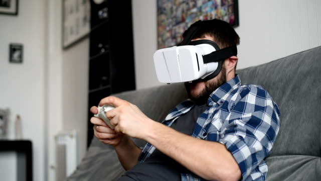 Young adult man and a virtual reality headset. Guy using vr glasses