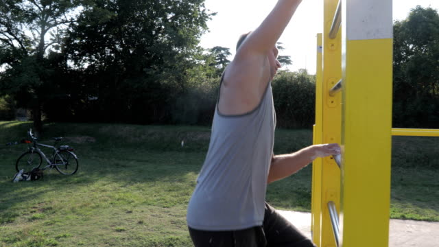 young adult man exercising on wall bars - twilight stock videos & royalty-free footage