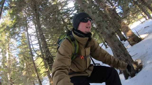 Young Adult Man Skiing Off the Beaten Path in Forest