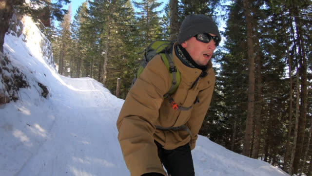 Young Adult Man Skiing Thru Forest