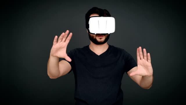 young adult man using virtual reality glasses