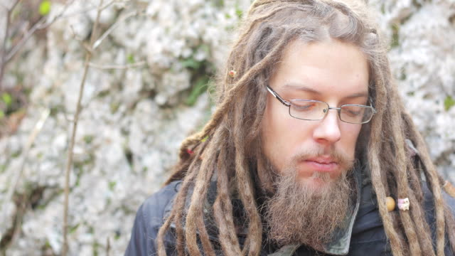 young adult man with dreadlocks camping in nature - protein bar stock videos & royalty-free footage