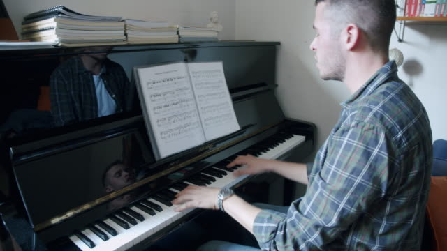 young adult singer pianist exercising at home - piano stock videos & royalty-free footage