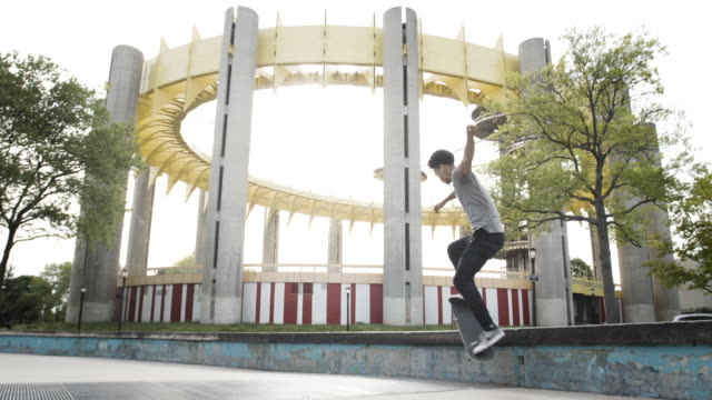 a young adult skateboards at a park in queens, nyc - 4k - flushing meadows corona park stock videos and b-roll footage