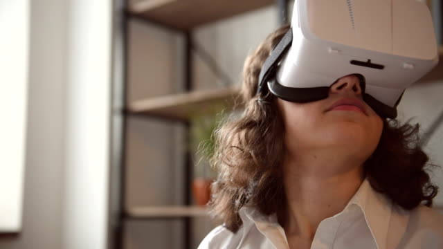 Young adult woman and a virtual reality headset. Girl using vr glasses