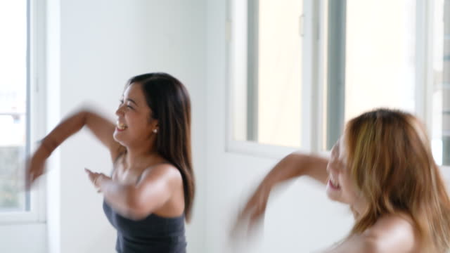 young adult woman dancing with friends - dance studio stock videos & royalty-free footage