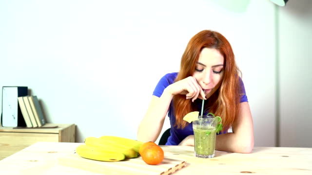 HD: Young Adult Woman Drinking Juice