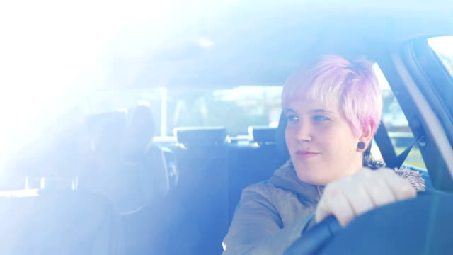 young adult woman driving a car - pink hair stock videos and b-roll footage