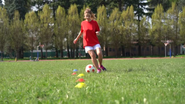 Young adult woman during a soccer training