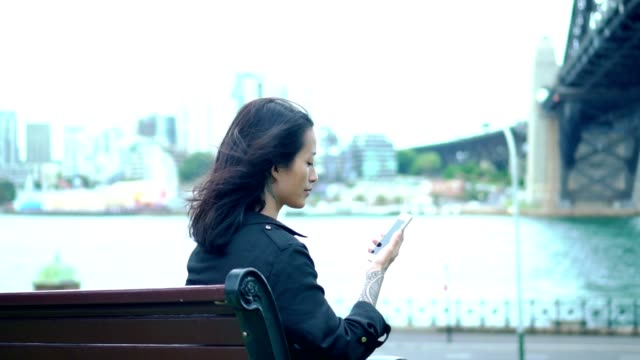 young adult woman have a break and looking something on digital tablet next to sydney harbour bridge - white collar worker stock videos and b-roll footage