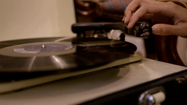 young adult woman looking at record player in second hand store - jukebox stock videos & royalty-free footage