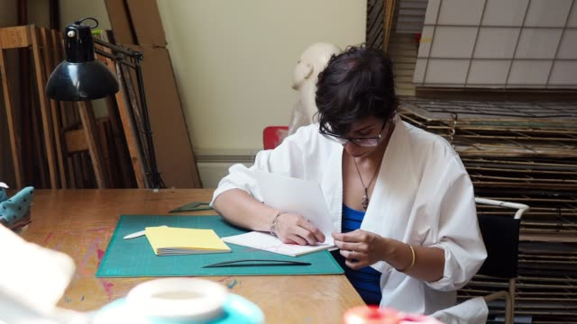 Young adult woman making a notebook