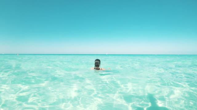 young adult woman relaxing in the sea - latin america stock videos & royalty-free footage