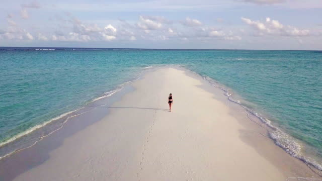 young adult woman walking on a sandbank against turquoise water in maldives - tourist resort stock videos & royalty-free footage