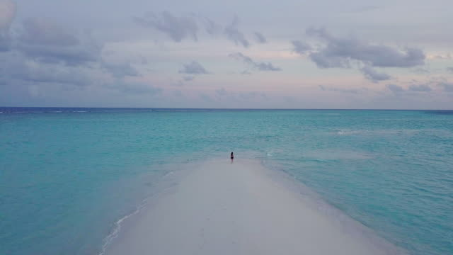young adult woman walking on a sandbank against turquoise water in maldives - turquoise coloured stock videos & royalty-free footage