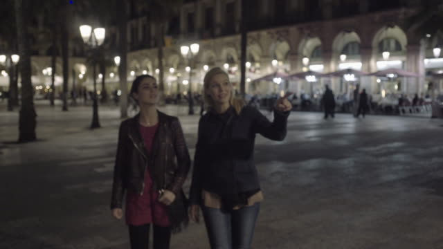 Young Adult Women at night visiting square in Barcelona