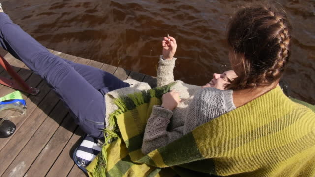 young adult women girls relaxing and smoking on a lake dock. - slow motion - zen like stock videos & royalty-free footage