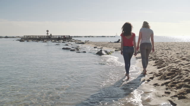 young adult women walking by the beach in summer - city break stock videos and b-roll footage
