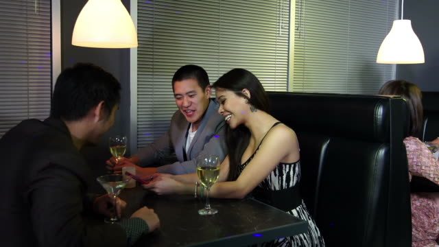 Young adults at an Asian nightclub have fun