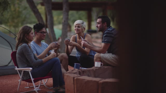 4K UHD: Young Adults Camping and Playing Cards