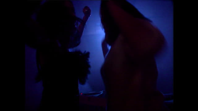 young adults dance in a colourful nightclub; 1992 - design stock videos & royalty-free footage