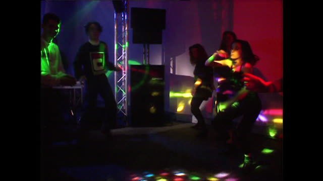 young adults dancing in a colourful nightclub setting; 1992 - nightclub stock videos & royalty-free footage
