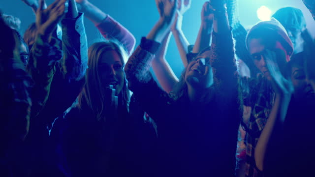 young adults dancing in club (slo-mo) - concert stock videos & royalty-free footage
