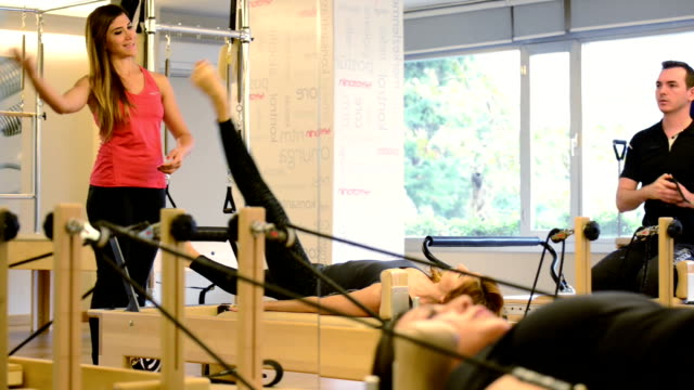 young adults exercising at pilates club - pilates stock videos & royalty-free footage
