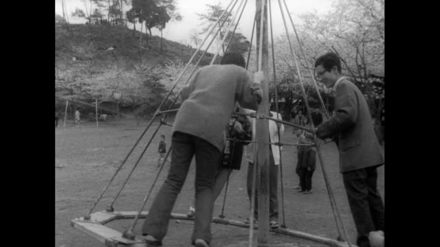 young adults have fun on playground equipment; 1962 - risk stock videos & royalty-free footage