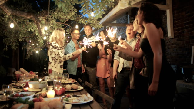 young adults have fun together at a summer garden party - formal garden party stock videos & royalty-free footage