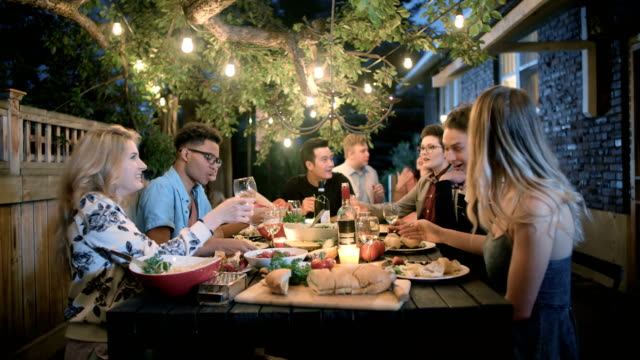 young adults have fun together at a summer garden party - dinner party stock videos & royalty-free footage