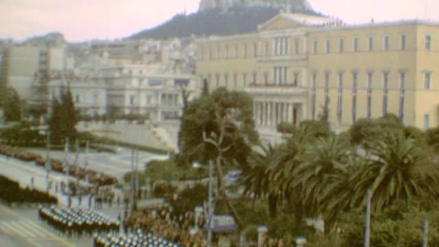vídeos y material grabado en eventos de stock de young adults march with greek flags / military parade / young girls / spectators / scouts / tanks on parade / greek independance day parade on march... - bandera griega