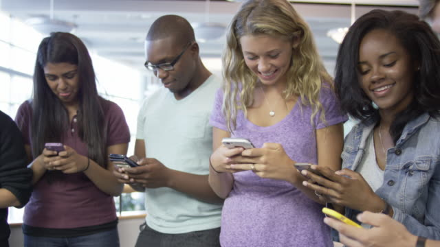 young adults on their cell phones - wap stock videos & royalty-free footage