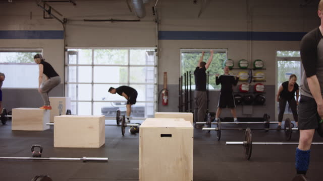 young adults participating in various cross training routines - cross training stock videos & royalty-free footage