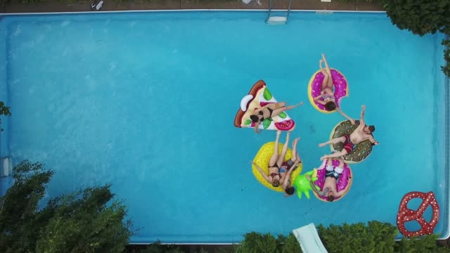 young adults pool party arial summer group part 6 - piscina video stock e b–roll