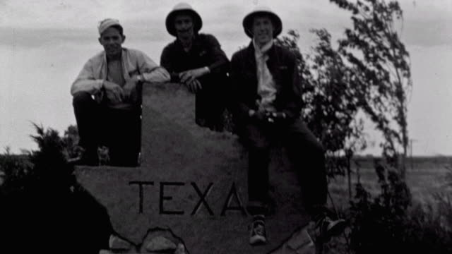 Young Adults Stretching after exiting Studebaker / Sitting Atop Texas Sign at Border / Panorama of Texas Landscape / Military Aircraft / Herding...