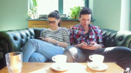 Young adults using phones these days.