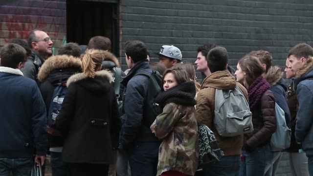 young adults walk through the shoreditch area of london united kingdom on monday 30 march 2015 shots a dog sits with his owner a group of young... - hipster person stock videos & royalty-free footage